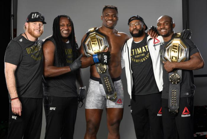 Francis Ngannou of Cameroon poses with his team backstage after his victory during the UFC 260 event at UFC APEX on March 27, 2021 in Las Vegas, Nevada. (Photo by Mike Roach/Zuffa LLC)