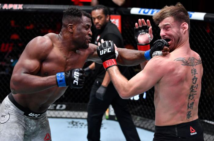 Francis Ngannou of Cameroon punches Stipe Miocic in their UFC heavyweight championship fight during the UFC 260 event at UFC APEX on March 27, 2021 in Las Vegas, Nevada. (Photo by Jeff Bottari/Zuffa LLC)