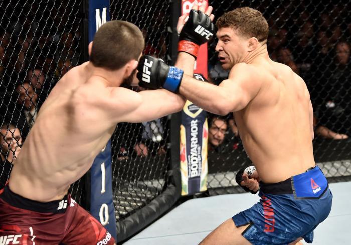 BROOKLYN, NEW YORK - APRIL 07:  (R-L) Al Iaquinta punches Khabib Nurmagomedov of Russia in their lightweight title bout during the UFC 223 event inside Barclays Center on April 7, 2018 in Brooklyn, New York. (Photo by Jeff Bottari/Zuffa LLC/Zuffa LLC via