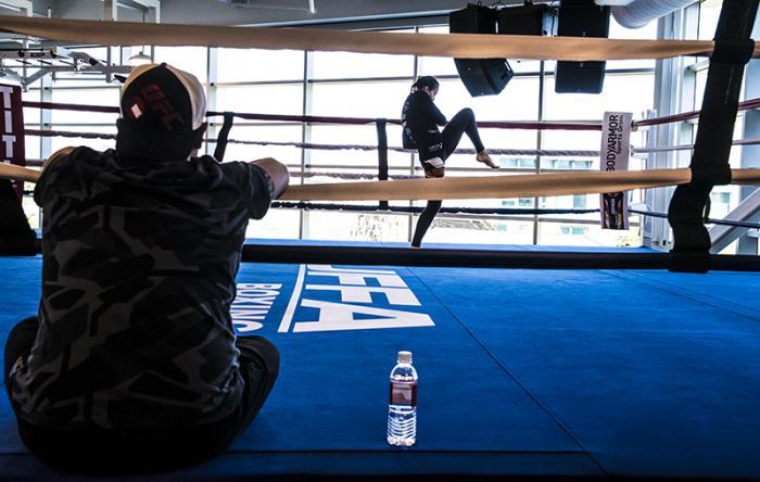 Las Vegas 5/27/18 - Antonina Shevchenko at the UFC Performance Institute in las Vegas preparing for Dana White's Tuesday Night Contender Series. her coach Pavel Fedotov watches. (Photo credit: Juan Cardenas)