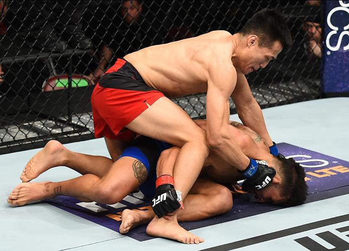 HOUSTON, TX - FEBRUARY 04:  (L-R) Chan Sung Jung of South Korea punches Dennis Bermudez in their featherweight bout during the UFC Fight Night event at the Toyota Center on February 4, 2017 in Houston, Texas. (Photo by Jeff Bottari/Zuffa LLC/Zuffa LLC via
