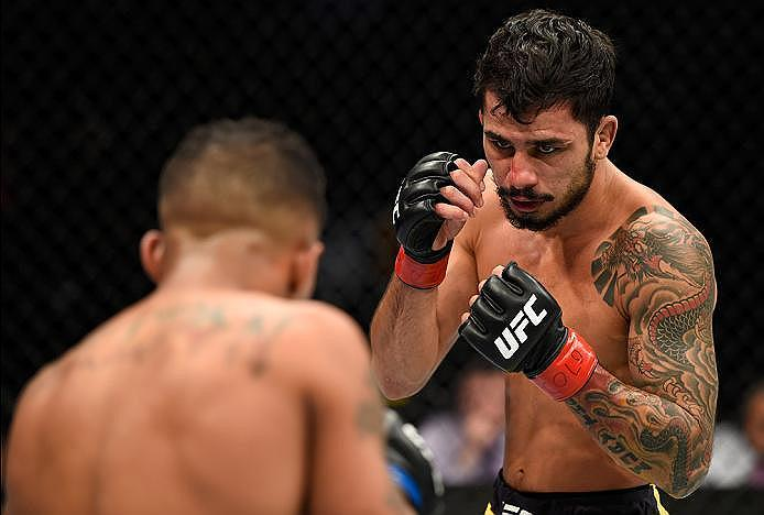 DENVER, CO - JANUARY 28:  (R-L) Alexandre Pantoja of Brazil circles Eric Shelton in their flyweight bout during the UFC Fight Night event at the Pepsi Center on January 28, 2017 in Denver, Colorado. (Photo by Josh Hedges/Zuffa LLC/Zuffa LLC via Getty Imag