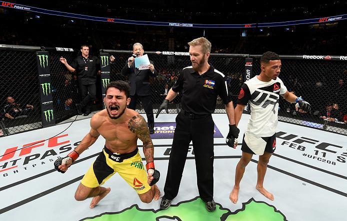 DENVER, CO - JANUARY 28:  (R-L) Alexandre Pantoja of Brazil celebrates his victory over Eric Shelton in their flyweight bout during the UFC Fight Night event at the Pepsi Center on January 28, 2017 in Denver, Colorado. (Photo by Josh Hedges/Zuffa LLC/Zuff