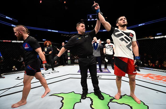 BROOKLYN, NEW YORK - FEBRUARY 11:  (R-L) Islam Makhachev of Russia celebrates his victory over Nik Lentz in their lightweight bout during the UFC 208 event inside Barclays Center on February 11, 2017 in Brooklyn, New York. (Photo by Jeff Bottari/Zuffa LLC