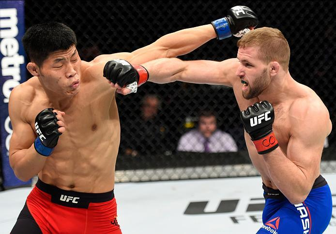DENVER, CO - JANUARY 28:  (R-L) Bobby Nash punches Li Jingliang of China in their welterweight bout during the UFC Fight Night event at the Pepsi Center on January 28, 2017 in Denver, Colorado. (Photo by Josh Hedges/Zuffa LLC/Zuffa LLC via Getty Images)