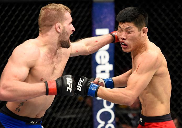 DENVER, CO - JANUARY 28:  (L-R) Bobby Nash punches Li Jingliang of China in their welterweight bout during the UFC Fight Night event at the Pepsi Center on January 28, 2017 in Denver, Colorado. (Photo by Josh Hedges/Zuffa LLC/Zuffa LLC via Getty Images)