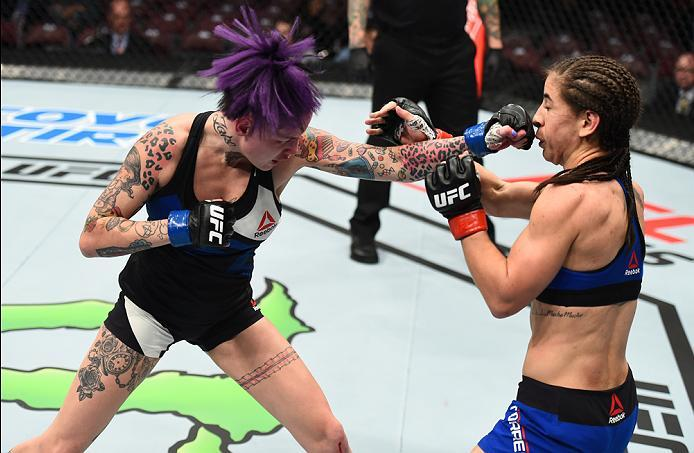 HOUSTON, TX - FEBRUARY 04:  (L-R) Bec Rawlings of Australia punches Tecia Torres  in their women's strawweight bout during the UFC Fight Night event at the Toyota Center on February 4, 2017 in Houston, Texas. (Photo by Jeff Bottari/Zuffa LLC/Zuffa LLC via