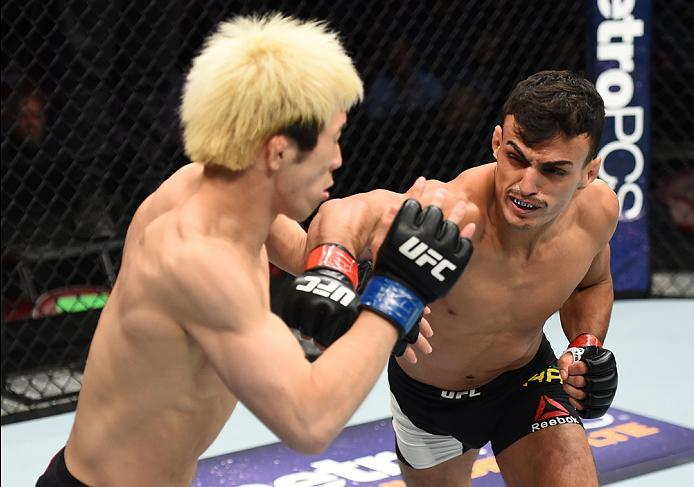 HOUSTON, TX - FEBRUARY 04:  (R-L) Ricardo Ramos of Brazil punches Michinori Tanaka of Japan in their bantamweight bout during the UFC Fight Night event at the Toyota Center on February 4, 2017 in Houston, Texas. (Photo by Jeff Bottari/Zuffa LLC/Zuffa LLC