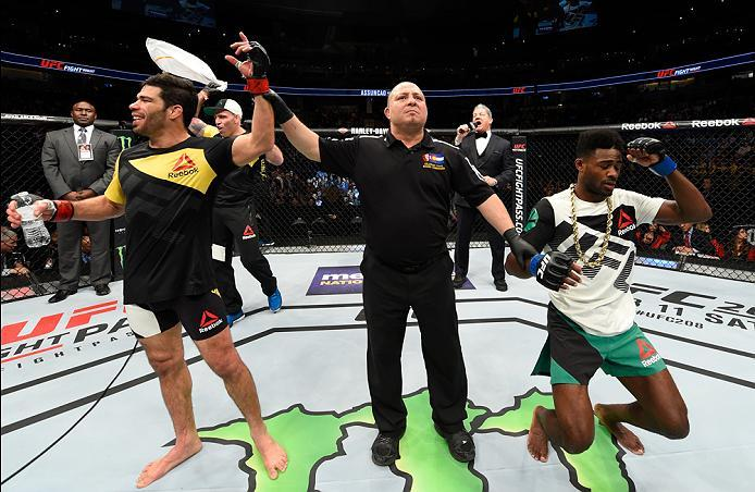 DENVER, CO - JANUARY 28:  (L-R) Raphael Assuncao of Brazil celebrates his victory over Aljamain Sterling in their bantamweight bout during the UFC Fight Night event at the Pepsi Center on January 28, 2017 in Denver, Colorado. (Photo by Josh Hedges/Zuffa L
