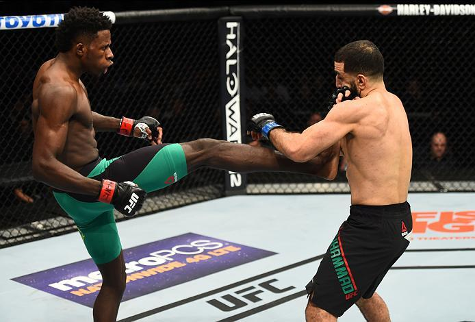 BROOKLYN, NEW YORK - FEBRUARY 11:  (L-R) Randy Brown of Jamaica kicks Belal Muhammad in their welterweight bout during the UFC 208 event inside Barclays Center on February 11, 2017 in Brooklyn, New York. (Photo by Jeff Bottari/Zuffa LLC/Zuffa LLC via Gett
