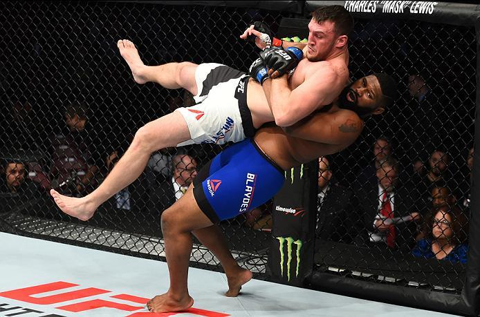 HOUSTON, TX - FEBRUARY 04:  (R-L) Curtis Blaydes takes down Adam Milstead in their heavyweight bout during the UFC Fight Night event at the Toyota Center on February 4, 2017 in Houston, Texas. (Photo by Jeff Bottari/Zuffa LLC/Zuffa LLC via Getty Images)