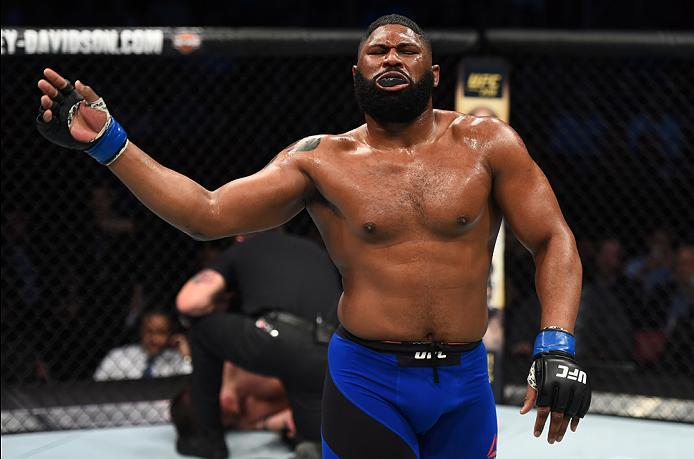 HOUSTON, TX - FEBRUARY 04:  (R-L) Curtis Blaydes celebrates his victory over Adam Milstead in their heavyweight bout during the UFC Fight Night event at the Toyota Center on February 4, 2017 in Houston, Texas. (Photo by Jeff Bottari/Zuffa LLC/Zuffa LLC vi