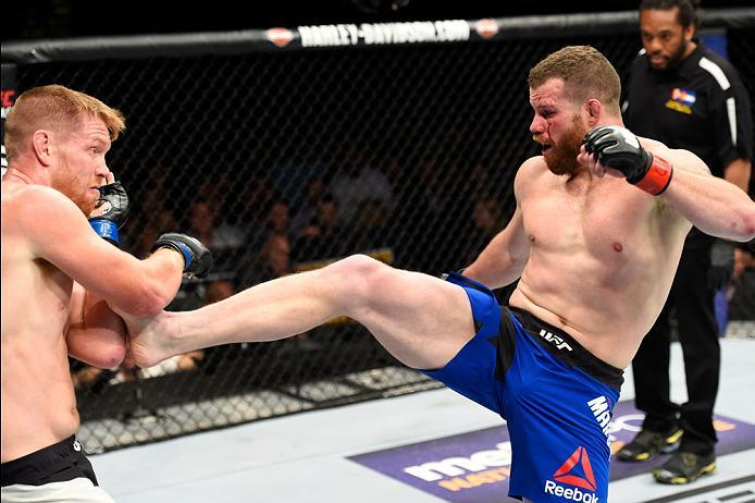 DENVER, CO - JANUARY 28:  (R-L) Nate Marquardt kicks Sam Alvey in their middleweight bout during the UFC Fight Night event at the Pepsi Center on January 28, 2017 in Denver, Colorado. (Photo by Josh Hedges/Zuffa LLC/Zuffa LLC via Getty Images)