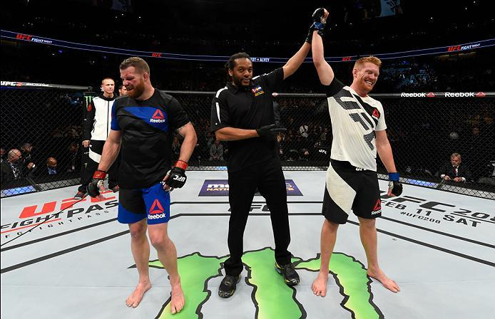 DENVER, CO - JANUARY 28:  (R-L) Sam Alvey celebrates his victory over Nate Marquardt in their middleweight bout during the UFC Fight Night event at the Pepsi Center on January 28, 2017 in Denver, Colorado. (Photo by Josh Hedges/Zuffa LLC/Zuffa LLC via Get