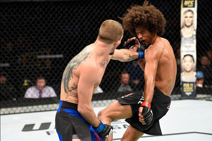 DENVER, CO - JANUARY 28:  (R-L) Jason Knight punches Alex Caceres in their featherweight bout during the UFC Fight Night event at the Pepsi Center on January 28, 2017 in Denver, Colorado. (Photo by Josh Hedges/Zuffa LLC/Zuffa LLC via Getty Images)