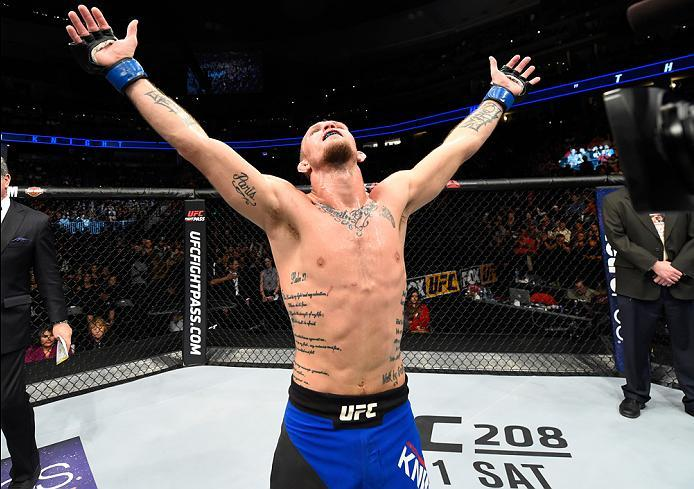 DENVER, CO - JANUARY 28:  Jason Knight attempts to celebrates his submission victory over Alex Caceres in their featherweight bout during the UFC Fight Night event at the Pepsi Center on January 28, 2017 in Denver, Colorado. (Photo by Josh Hedges/Zuffa LL