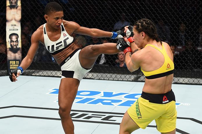 HOUSTON, TX - FEBRUARY 04:  (L-R) Angela Hill kicks Jessica Andrade of Brazil in their women's strawweight bout during the UFC Fight Night event at the Toyota Center on February 4, 2017 in Houston, Texas. (Photo by Jeff Bottari/Zuffa LLC/Zuffa LLC via Get