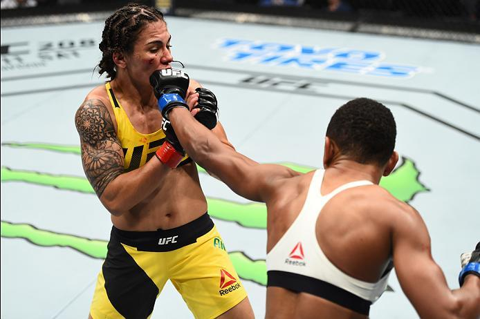 HOUSTON, TX - FEBRUARY 04:  (R-L) Angela Hill punches Jessica Andrade of Brazil in their women's strawweight bout during the UFC Fight Night event at the Toyota Center on February 4, 2017 in Houston, Texas. (Photo by Jeff Bottari/Zuffa LLC/Zuffa LLC via G