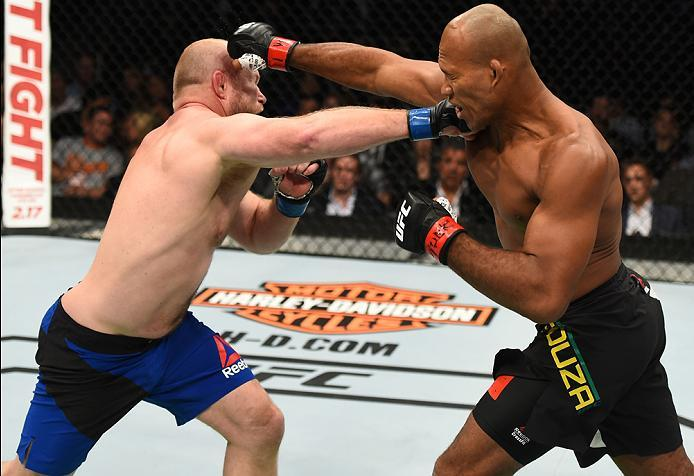 BROOKLYN, NEW YORK - FEBRUARY 11:  (L-R) Tim Boetsch punches Ronaldo Souza of Brazil in their middleweight bout during the UFC 208 event inside Barclays Center on February 11, 2017 in Brooklyn, New York. (Photo by Jeff Bottari/Zuffa LLC/Zuffa LLC via Gett