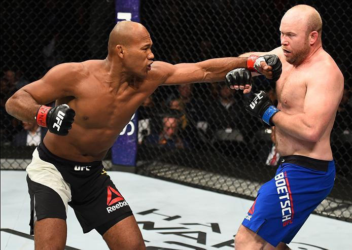 BROOKLYN, NEW YORK - FEBRUARY 11:  (L-R) Ronaldo Souza of Brazil punches Tim Boetsch in their middleweight bout during the UFC 208 event inside Barclays Center on February 11, 2017 in Brooklyn, New York. (Photo by Jeff Bottari/Zuffa LLC/Zuffa LLC via Gett