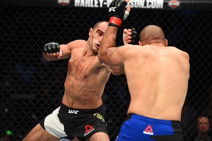 HOUSTON, TX - FEBRUARY 04:  (L-R) Marcel Fortuna of Brazil punches Anthony Hamilton in their heavyweight bout during the UFC Fight Night event at the Toyota Center on February 4, 2017 in Houston, Texas. (Photo by Jeff Bottari/Zuffa LLC/Zuffa LLC via Getty