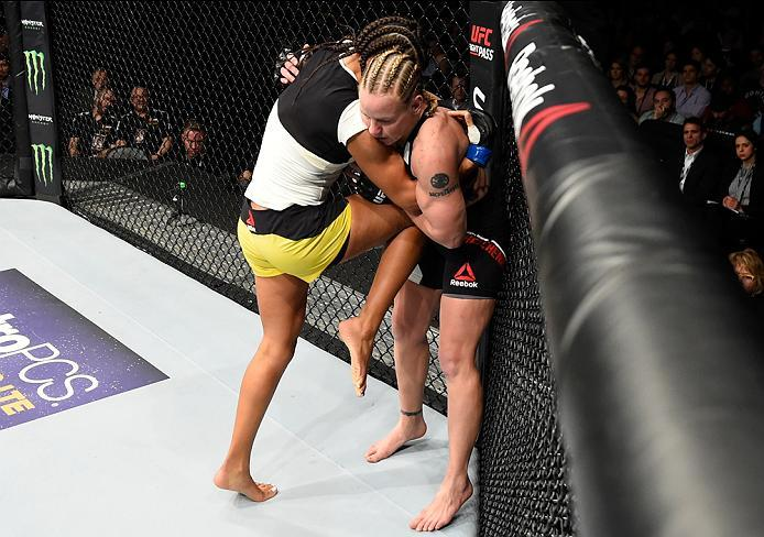 DENVER, CO - JANUARY 28:  (L-R) Julianna Pena knees Valentina Shevchenko of Kyrgyzstan in their women's bantamweight bout during the UFC Fight Night event at the Pepsi Center on January 28, 2017 in Denver, Colorado. (Photo by Josh Hedges/Zuffa LLC/Zuffa L