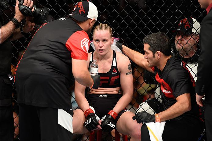 DENVER, CO - JANUARY 28:  Valentina Shevchenko of Kyrgyzstan receives advice from her corner in between rounds while facing Julianna Pena in their women's bantamweight bout during the UFC Fight Night event at the Pepsi Center on January 28, 2017 in Denver