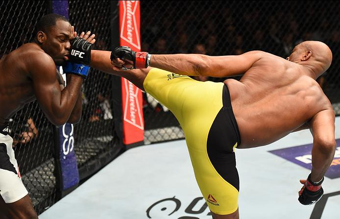 BROOKLYN, NEW YORK - FEBRUARY 11:  (R-L) Anderson Silva of Brazil kicks Derek Brunson in their middleweight bout during the UFC 208 event inside Barclays Center on February 11, 2017 in Brooklyn, New York. (Photo by Jeff Bottari/Zuffa LLC/Zuffa LLC via Get