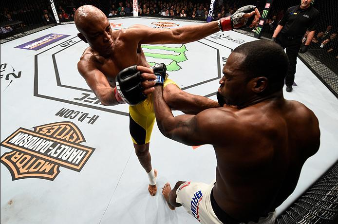 BROOKLYN, NEW YORK - FEBRUARY 11:  (L-R) Anderson Silva of Brazil kicks Derek Brunson in their middleweight bout during the UFC 208 event inside Barclays Center on February 11, 2017 in Brooklyn, New York. (Photo by Jeff Bottari/Zuffa LLC/Zuffa LLC via Get