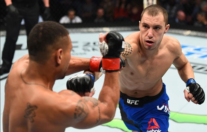 HOUSTON, TX - FEBRUARY 04:  (R-L) James Vick punches Abel Trujillo in their lightweight bout during the UFC Fight Night event at the Toyota Center on February 4, 2017 in Houston, Texas. (Photo by Jeff Bottari/Zuffa LLC/Zuffa LLC via Getty Images)