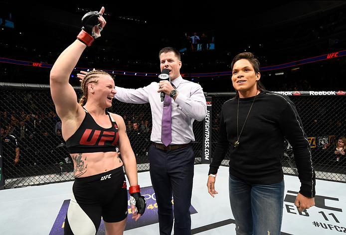 DENVER, CO - JANUARY 28:  (L-R) Valentina Shevchenko of Kyrgyzstan and UFC women's bantamweight champion Amanda Nunes speak to Brian Stan during the UFC Fight Night event at the Pepsi Center on January 28, 2017 in Denver, Colorado. (Photo by Josh Hedges/Z