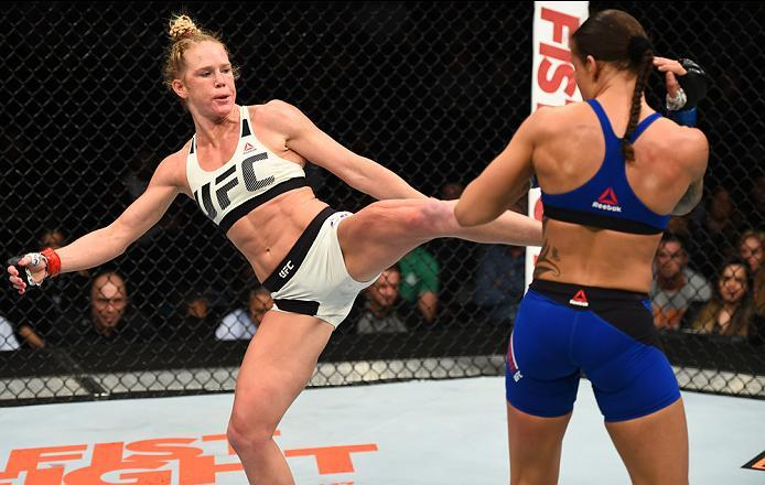 BROOKLYN, NEW YORK - FEBRUARY 11:  (L-R) Holly Holm kicks Germaine de Randamie of The Netherlands in their women's featherweight championship bout during the UFC 208 event inside Barclays Center on February 11, 2017 in Brooklyn, New York. (Photo by Jeff B