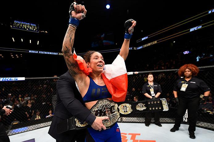 BROOKLYN, NEW YORK - FEBRUARY 11:  Germaine de Randamie of The Netherlands celebrates her victory over Holly Holm in their women's featherweight championship bout during the UFC 208 event inside Barclays Center on February 11, 2017 in Brooklyn, New York.