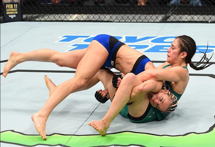 HOUSTON, TX - FEBRUARY 04:  (L-R) Felice Herrig takes down Alexa Grasso of Mexico in their women's strawweight bout during the UFC Fight Night event at the Toyota Center on February 4, 2017 in Houston, Texas. (Photo by Jeff Bottari/Zuffa LLC/Zuffa LLC via