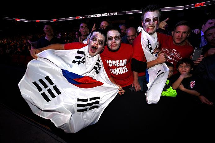 HOUSTON, TX - FEBRUARY 04:  Fans pose for a picture during the UFC Fight Night event at the Toyota Center on February 4, 2017 in Houston, Texas. (Photo by Jeff Bottari/Zuffa LLC/Zuffa LLC via Getty Images)