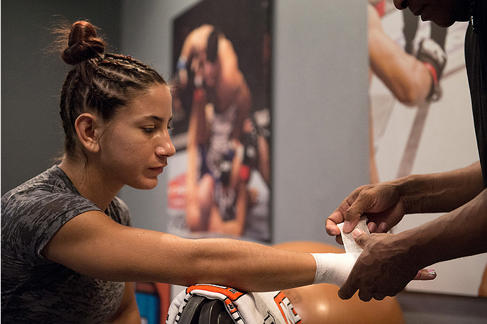 LAS VEGAS, NV - JULY 28:  Team Pettis fighter Tecia Torres gets her hands wrapped before facing team Melendez fighter Bec Rawlings during filming of season twenty of The Ultimate Fighter on July 28, 2014 in Las Vegas, Nevada. (Photo by Brandon Magnus/Zuff