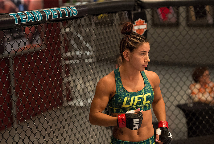 LAS VEGAS, NV - JULY 28:  Team Pettis fighter Tecia Torres enters the Octagon before facing team Melendez fighter Bec Rawlings during filming of season twenty of The Ultimate Fighter on July 28, 2014 in Las Vegas, Nevada. (Photo by Brandon Magnus/Zuffa LL