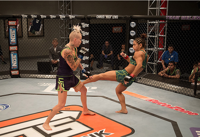 LAS VEGAS, NV - JULY 28:  (R-L) Team Pettis fighter Tecia Torres kicks team Melendez fighter Bec Rawlings during filming of season twenty of The Ultimate Fighter on July 28, 2014 in Las Vegas, Nevada. (Photo by Brandon Magnus/Zuffa LLC/Zuffa LLC via Getty