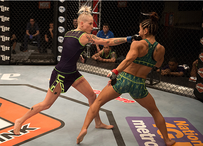 LAS VEGAS, NV - JULY 28:  (L-R) Team Melendez fighter Bec Rawlings punches team Pettis fighter Tecia Torres during filming of season twenty of The Ultimate Fighter on July 28, 2014 in Las Vegas, Nevada. (Photo by Brandon Magnus/Zuffa LLC/Zuffa LLC via Get