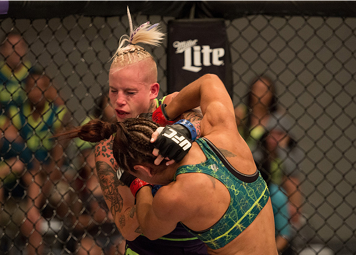 LAS VEGAS, NV - JULY 28:  (R-L) Team Pettis fighter Tecia Torres punches team Melendez fighter Bec Rawlings during filming of season twenty of The Ultimate Fighter on July 28, 2014 in Las Vegas, Nevada. (Photo by Brandon Magnus/Zuffa LLC/Zuffa LLC via Get