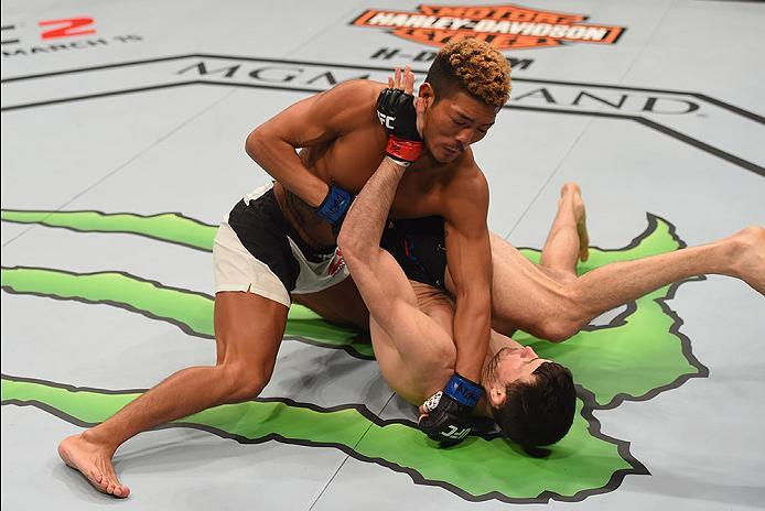LAS VEGAS, NV - MARCH 05: Teruto Ishihara of Japan (top) punches Julian Erosa in their featherweight bout during the UFC 196 event inside MGM Grand Garden Arena on March 5, 2016 in Las Vegas, Nevada.  (Photo by Josh Hedges/Zuffa LLC/Zuffa LLC via Getty Im