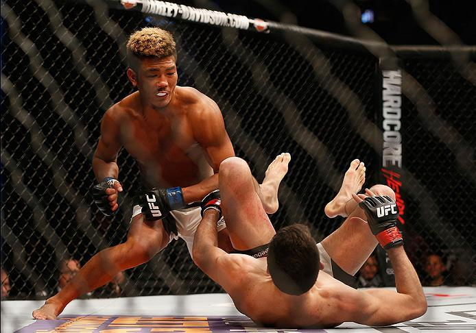 LAS VEGAS, NV - MARCH 05: Teruto Ishihara of Japan (top) punches Julian Erosa in their featherweight bout during the UFC 196 event inside MGM Grand Garden Arena on March 5, 2016 in Las Vegas, Nevada.  (Photo by Christian Petersen/Zuffa LLC/Zuffa LLC via G