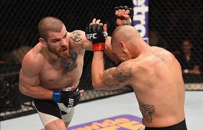LAS VEGAS, NV - MARCH 05: (L-R) Jim Miller punches Diego Sanchez in their lightweight bout during the UFC 196 event inside MGM Grand Garden Arena on March 5, 2016 in Las Vegas, Nevada.  (Photo by Josh Hedges/Zuffa LLC/Zuffa LLC via Getty Images) *** Local