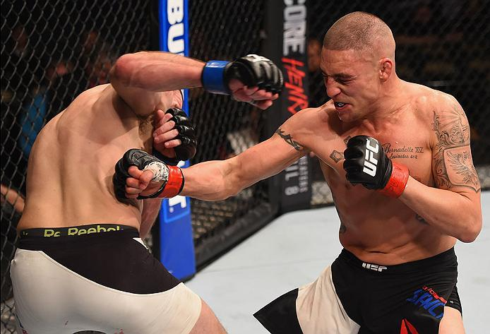 LAS VEGAS, NV - MARCH 05: (R-L) Diego Sanchez punches Jim Miller in their lightweight bout during the UFC 196 event inside MGM Grand Garden Arena on March 5, 2016 in Las Vegas, Nevada.  (Photo by Josh Hedges/Zuffa LLC/Zuffa LLC via Getty Images) *** Local