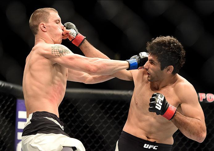 INGLEWOOD, CA - JUNE 04:  James Vick and Beneil Darush of Iran exchange blows in their lightweight bout during the UFC 199 event at The Forum on June 4, 2016 in Inglewood, California.  (Photo by Harry How/Zuffa LLC/Zuffa LLC via Getty Images)