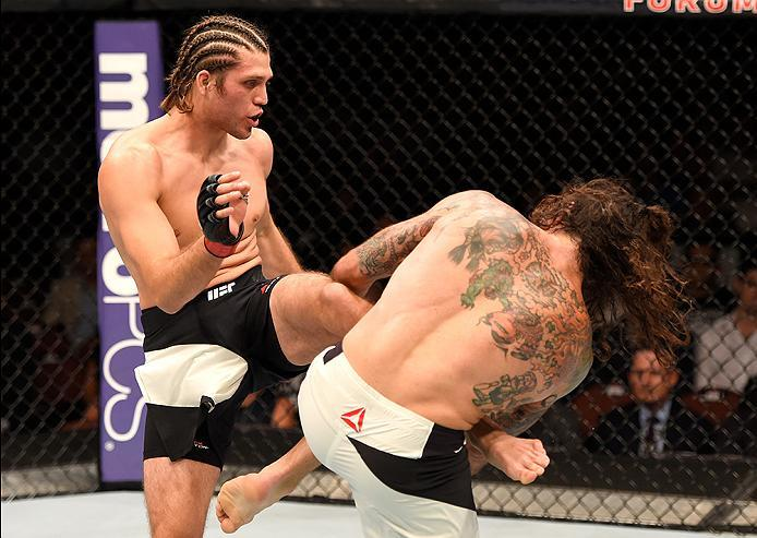 INGLEWOOD, CA - JUNE 04: Brian Ortega kicks Clay Guida in their featherweight bout during the UFC 199 event at The Forum on June 4, 2016 in Inglewood, California.  (Photo by Josh Hedges/Zuffa LLC/Zuffa LLC via Getty Images)
