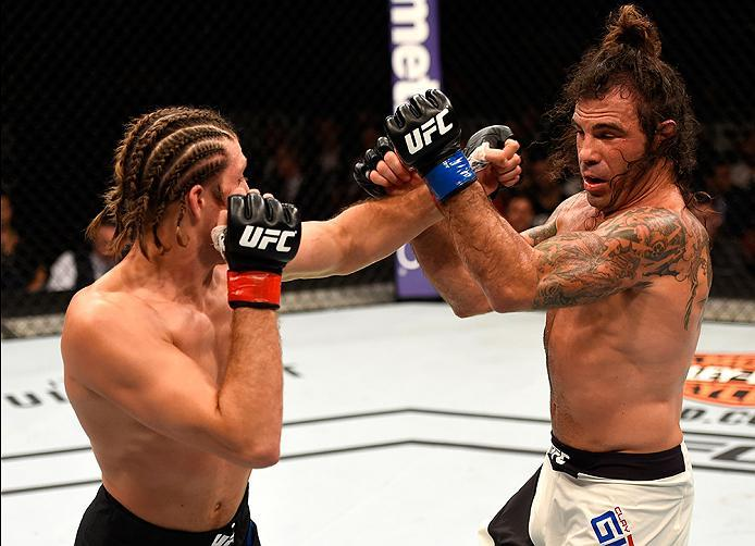 INGLEWOOD, CA - JUNE 04: Brian Ortega punches Clay Guida in their featherweight bout during the UFC 199 event at The Forum on June 4, 2016 in Inglewood, California.  (Photo by Josh Hedges/Zuffa LLC/Zuffa LLC via Getty Images)