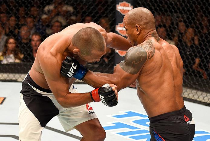 INGLEWOOD, CA - JUNE 04:  Dan Henderson and Hector Lombard of Cuba exchange blows in their middleweight bout during the UFC 199 event at The Forum on June 4, 2016 in Inglewood, California.  (Photo by Josh Hedges/Zuffa LLC/Zuffa LLC via Getty Images)