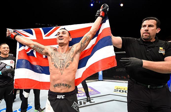 INGLEWOOD, CA - JUNE 04: Max Holloway celebrates after defeating Ricardo Lamas by unanimous decision in their featherweight bout during the UFC 199 event at The Forum on June 4, 2016 in Inglewood, California.  (Photo by Josh Hedges/Zuffa LLC/Zuffa LLC via