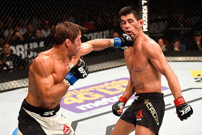 INGLEWOOD, CA - JUNE 04: Urijah Faber throws a left punch at Dominick Cruz in their UFC bantamweight championship bout during the UFC 199 event at The Forum on June 4, 2016 in Inglewood, California.  (Photo by Josh Hedges/Zuffa LLC/Zuffa LLC via Getty Ima